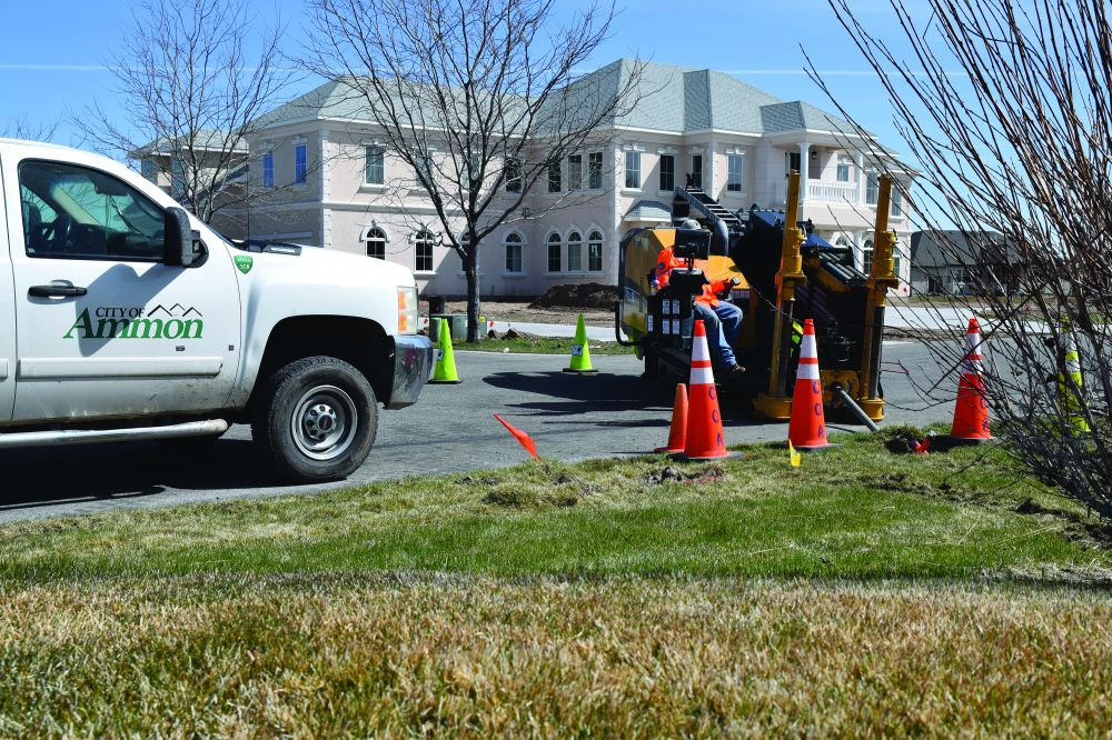 An Ammon operator uses a directional drill to install a fiber drop