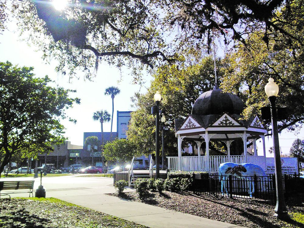 The gazebo in Ocala's downtown square and the Horse Fever sculpture
